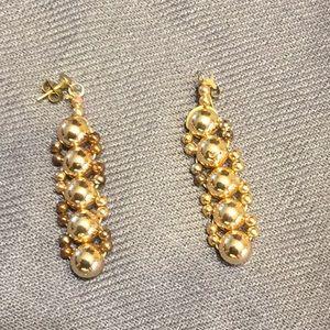 Gold earrings and bracelet.